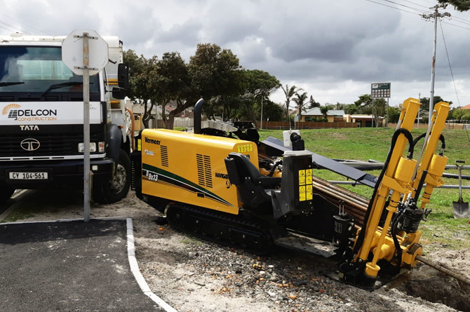 Drilling trenching next to road